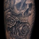 Chris DeLauder Tattoo Artist black and grey skull and rose
