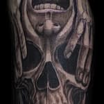Chris DeLauder Tattoo Artist black and grey skull and face