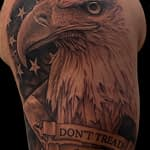 Chris DeLauder Tattoo Artist black and grey eagle and flag before