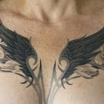 Chris DeLauder Tattoo Artist black and grey wings flowers full chest 3