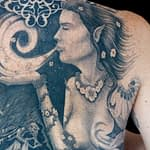 Chris DeLauder Tattoo Artist black and grey right back